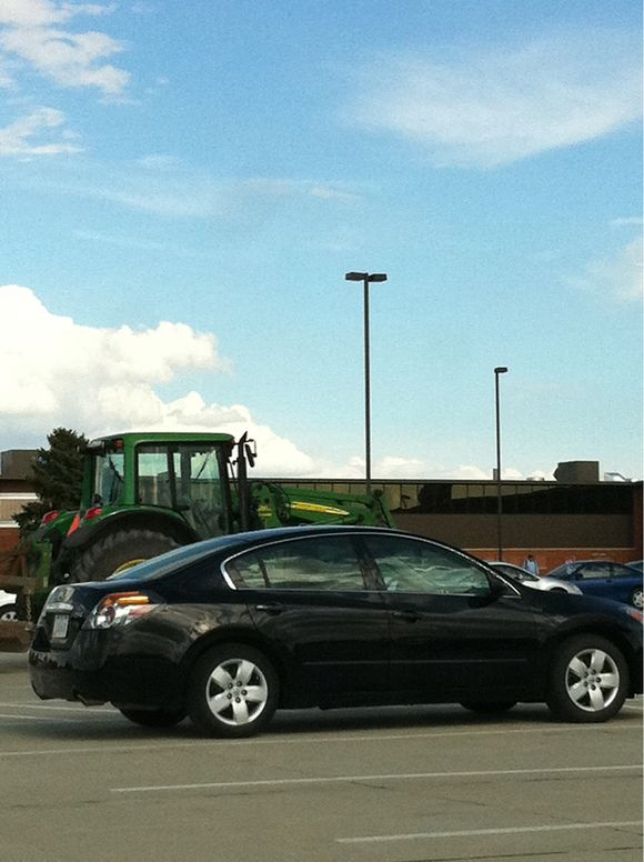 Where Does a Green and Yellow Tractor Park